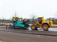 wintertraining balkman en asfaltafwerkmachine